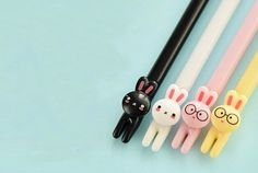 This pack of 4 cartoon rabbit design black gel ink pens is perfect for kids, as a gift or as an addition to your school supplies collection. It comes in four different barrel colors: black, white, yellow and pink. Stationary School, Cute Stationary, Stationary Supplies, Kawaii Bunny, Kawaii Cute, Kawaii Stuff, Kids Rewards, Cute Pens, Pen Collection