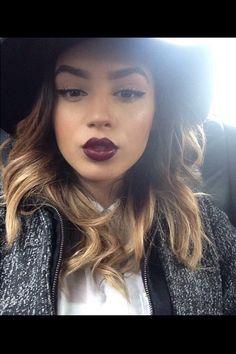 Eyeliner, eyebrows, dark lipstick