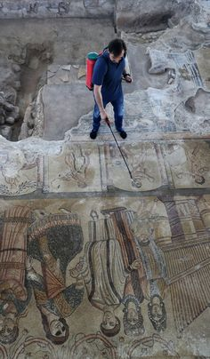 Miguel Angel Valero sprays deionized water on a scene representing a pantomime. A pipe organ can be seen to the right Roman Roads, Archaeology News, Information Center, Miguel Angel, Spain And Portugal, Roman Empire, Ancient History, Old Things, Villa