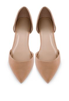 """It's a fashion victory!TheseCosette Flats in nude featurefaux leather in a ballet flat styling with a pointed toe andD'orsay styling. Cushioned insole and rubber bottom sole with nonskid markings. Slip-on style.*Man Made Materials*3"""" Shaft Height*0.25"""" Heel Height*Imported"""