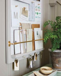 Entryway-Organizer How-To Ours is a basic store-bought corkboard that's been painted and outfitted with a ledge and rod (to hold larger mail), plus cup hooks (for keys). Keep the family's monthly calendar here, too, for at-a-glance reminders of doctor appointments and meetings.