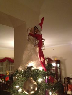 "I thought it was ""under the mistletoe"" ... not up on the tree top!"