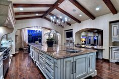 You can whip up just about anything in this no-expense-spared kitchen. black stainless appliances would blend beautifully with elegantly rustic architectural details such as the solid hand-hewn and distressed ceiling beams and solid white oak hand-distressed floors. #LGLimitlessDesign & #Contest