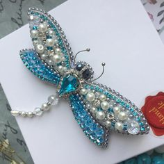 Items similar to Handmade brooch jewelry Dragonfly embroidered from beads and rhinestones on Etsy Bead Embroidery Jewelry, Beaded Jewelry Patterns, Beaded Embroidery, Beaded Dragonfly, Dragonfly Jewelry, Beaded Brooch, Beaded Earrings, Brooches Handmade, Handmade Jewelry