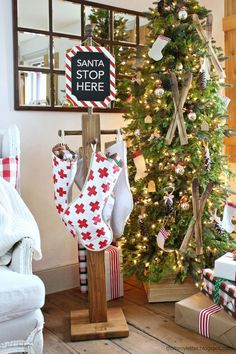 Make your own stocking holder post with this tutorial from Jamie Costiglio! Christmas Stocking Stand, Christmas Signs, Homemade Christmas, Rustic Christmas, Winter Christmas, All Things Christmas, Christmas Decorations, Christmas Ornaments, Christmas Stockings