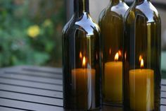 wine bottle candles, great way to keep candles from blowing out outside