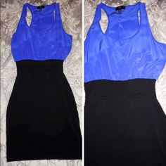 Blue & Black dress by Aqua Aqua Dress bought at Bloomingdales. Size small. 94% rayon, 6% spandex trim, 100% silk top. Worn once, like new. Aqua Dresses Mini
