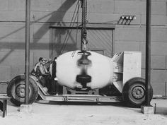 Fat Man Bomb on its transport carriage....Fat Man – the bomb that was detonated over Nagasaki, Japan. Here it is seen on a transport carriage after assembly on Tinian Island, 1945.