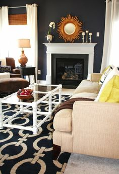 Similar to what our fireplace will look like, dark blue wall, white mantel, dark tile. We have carpet and no Windows on the side