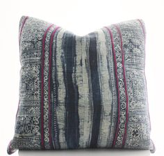 This pillow cover is sewn from 2 pieces of vintage, handwoven, indigo, Hmong textile featuring dark pink embroidered lines.  PILLOW COVER SIZE: 20x20