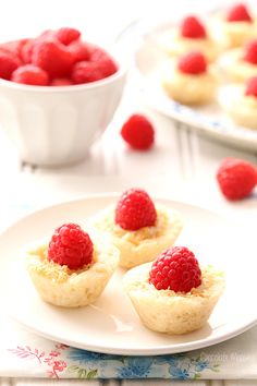 Raspberry Coconut Mini Pies brings a bit of elegance to dessert tables with homemade pie crust, coconut pudding, and sweet whole raspberries #DriscollsBerry