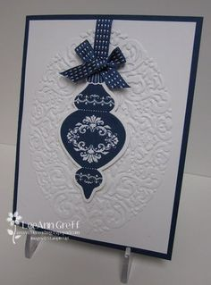 handmade Christmas card ... white and navy ... clean and simple ... stamped and cut out baulble ... ribbon and bow hanger ... embossing folder texture ... Stampin' Up!