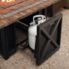Outdoor fire pit - hide that unsightly propane tank Fire Pit Ring, Diy Fire Pit, Fire Pit Backyard, Foyer Propane, Outdoor Propane Fireplace, Gas Fire Table, Fire Pit Furniture, Concrete Furniture, Concrete Projects