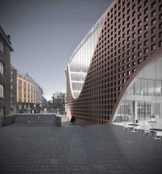 University of Helsinki library, Finland by Anttinen Oiva Architects, Construction year: 2010-2012  The new library building complements the urban block by adding a curved brick facade, integrated within the street line formed by the adjacent buildings.  photo : Mika Huisman