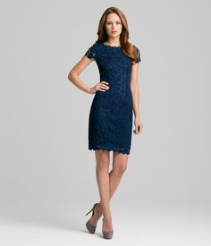 LOLLY DRESS    Elie Tahari is synonymous with extraordinary detail. Our best-selling, all-over-floral-lace Lolly Dress in a trendsetting, Spring-perfect navy is no exception.