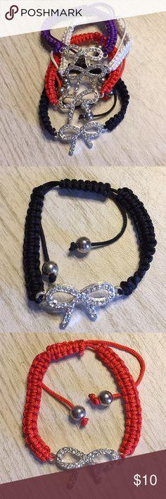 Set of 4 Ribbon Bow Knot Friendship Bracelets All 4 bracelets. Adjustable Cord Macrame Friendship Bracelets. CZ Ribbon Bow Knot.  Receive all 4. Black, Red, White and Purple. Jewelry Bracelets