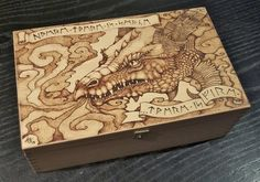 Image from http://fc08.deviantart.net/fs70/i/2013/142/d/2/pyrography_dragon_box_by_bluemidna-d666xjj.jpg.