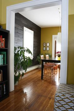 Love this wall design  - Shiplap wall that creates texture and the mustard yellow. I <3 mustard yellow!