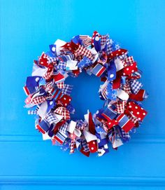 """MATERIALS  · Scrap fabric in 7-10 patterns, cut into ten 14"""" x 1½"""" strips per pattern  · 12"""" round foam floral and craft ring  · Scissors  · 6"""" length of floral wire 1.  Loop a fabric strip around the ring, right side out, and tie in a double knot at the front. 2.  Continue around the entire ring, alternating fabric patterns and staggering placement of knots. Every few inches, scrunch the strips together  3.  Loop floral wire through fabric on the back of the wreath to create a hanger."""