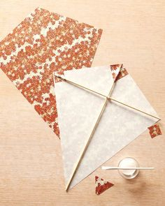 Martha Stewart: paper kite tutorial.....it would be fun for each child to build a kite at the party.