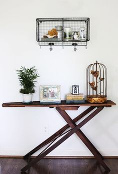 vintage wooden ironing board as a console table.