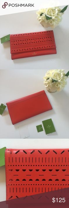 [ Kate Spade ]Cherry Red Lillian Court Neva clutch NWT Includes all tags and booklet , Cherry red laser cut out oversized clutch. Super cute design and smooth leather, 3 separate pockets inside including the zipper pouch. Magnetic closure. Such a statement piece would also make a wonderful gift! kate spade Bags Clutches & Wristlets