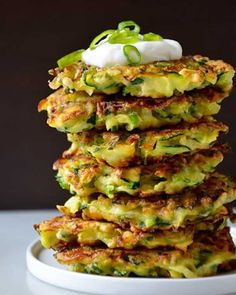 5-ingredient Zucchini Fritters- Whether you're looking for low carb snacks, side dishes, or apps, this recipe should be one of the first on your list. With just five wholesome ingredients and 25 minutes, you can transform the summer veggie into addicting crispy fritters.