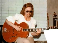 Carol Kaye and her CK and her Emperor Epiphone Guitar 1971 Carol's Emperor was Phil Spector's favorite.  Photo by Greg Schneider