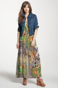 Denim jacket over a loud printed maxi-dress--perfect casual outfit