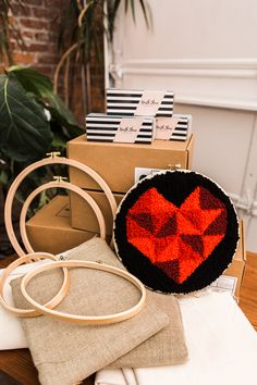 Geo Heart Kit Kit includes: - Adjustable wood handle punch needle tool with threader OR Oxford Regular Punch Needle tool - Monks cloth fabric - wood Nurge embroidery hoop - Yarn bundles - Design template and instruction booklet How To Make Punch, Framed Fabric, Fabric Frame, Punch Needle Kits, Monks Cloth, Wooden Hoop, Sewing Stitches, Penny Rugs, Linocut Prints