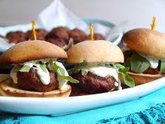Gyro sliders topped with a tangy dill yogurt sauce