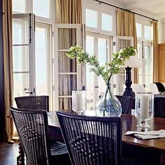 dining rooms - white french doors yellow silk drapes farmhouse dining table black dining chairs glass vase  LOVE the row of French doors and