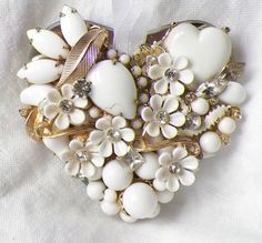 Flowery Whites Vintage Jewelry Embellished Mirrored Heart Ornament. $26.00, via Etsy.