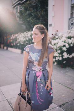 Gal Meets Glam Wall of Roses - Ted Baker dress, and Prada bag.