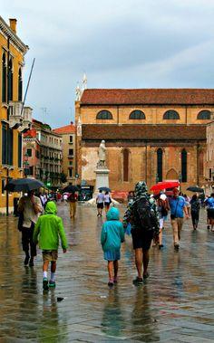 VENICE, ITALY- Walking in the rain in one of the plazas near Basilica Santa Maria della Salute