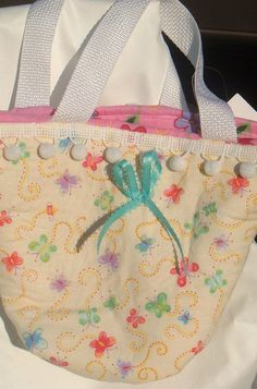 Little girl's butterfly print purse.