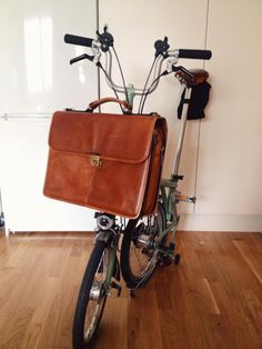 This is my bike with the briefcase my fiancée got me for Christmas. Can't wait to install the luggage frame inside the bag!