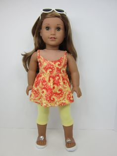 Pretty yellow and orange summer top by JazzyDollDuds on Etsy. Made with the LJC CA Cami Top pattern.  Get it at http://www.pixiefaire.com/collections/liberty-jane/products/ca-cami-top-18-doll-clothes. #pixiefaire #libertyjane #cacamitop