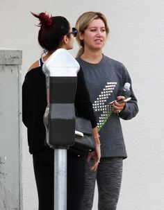 Ashley Tisdale and Vanessa Hudgens stop to chat after their workouts in Studio City, California on October 16, 2014
