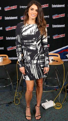 Nikki Reed in a black-and-white printed long-sleeve dress