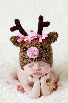 Too many babies with reindeer hats. (Also what kind of baby sits like that???)