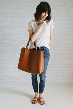 white tee | denims | oversize tan leather bag