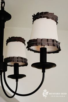 I want to paint the old brass chandelier over in the dining room black and add shades with a pop of color...this might be a good idea.