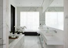 Modern bathroom design with white marble looking tile http://www.bauformatusa.com