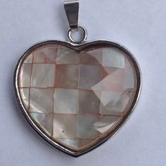 Natural Shell Pendant Love heart with faceted natural shell set in 18k WGP. New! Jewelry