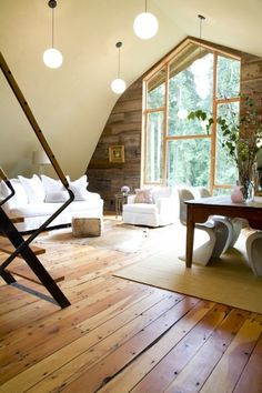 This room looks like it might be part of a renovated barn. #home #decor #architecture