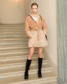 Karlie Kloss in a Maiyet coat, Isabel Marant dress, Gigi Burris Millinery headpiece, Proenza Schouler shoes