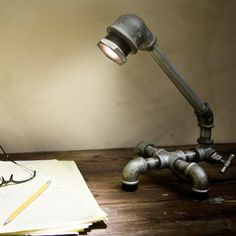 Industrial DIY lamp! I'll have to get on this and make one for my desk.