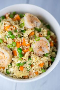 A healthy and delicious vegetable packed Chinese shrimp fried cauliflower rice bowl. Cauliflower florets substitute white rice for this savory one pot dish.