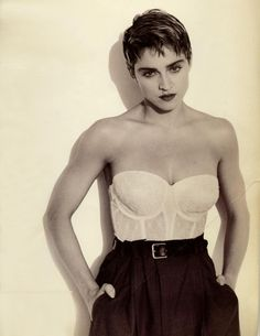 Madonna back in the late 80's early 90's...before she started really plucking her eyebrows...by Herb Ritts